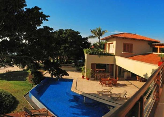 Estate Aurora is a 7,000 square foot, beachfront villa with modern design and Mediterranean style in the Punta Mita resort. This property is located 35 minutes north of Puerto Vallarta and is in the exclusive gated community of